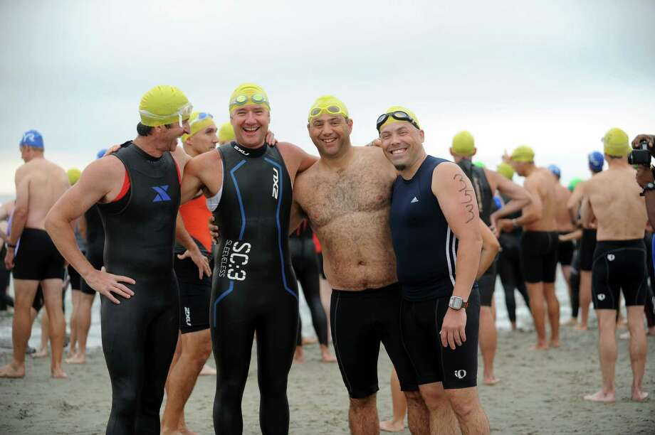 From left, Paul Walters, Geoff Massam, Danny Stein and Jonathan Wilson, all Greenwich, pose before the Betteridge Greenwich Cup Triathlon at Greenwich Point, in Old Greenwich, Conn., Sunday, July 28, 2013. Photo: Helen Neafsey / Greenwich Time