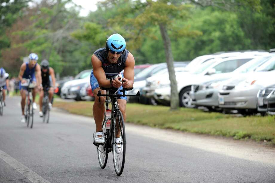 Men bike during the Betteridge Greenwich Cup Triathlon at Greenwich Point, in Old Greenwich, Conn., Sunday, July28, 2013. Photo: Helen Neafsey / Greenwich Time