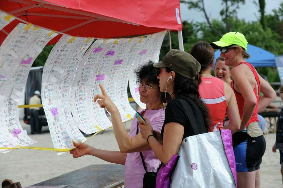 Women look for their numbers at the Betteridge Greenwich Cup Triathlon at Greenwich Point, in Old Greenwich, Conn., Sunday, July 28, 2013. Photo: Helen Neafsey / Greenwich Time