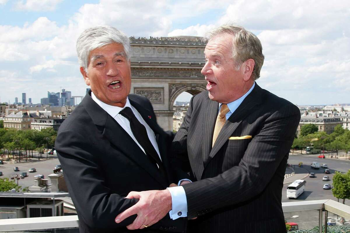Maurice Levy, left, Chief Executive of French advertising group Publicis, and John Wren, head of Omnicom Group pose during a joint news conference in Paris, France, Sunday, July 28, 2013. Publicis and Omnicom have announced merger plans to create the world's biggest advertising group (AP Photo/Francois Mori)