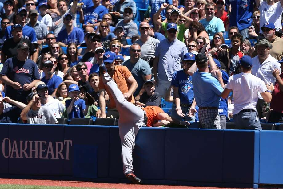 Brett Wallace of the Astros is unable to locate a ball hit in foul territory. Photo: Tom Szczerbowski, Getty Images