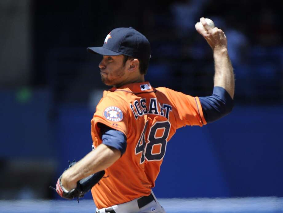 Astros pitcher Jarred Cosart delivers a throw to the Blue Jays. Photo: Jon Blacker, Associated Press/The Canadian Press