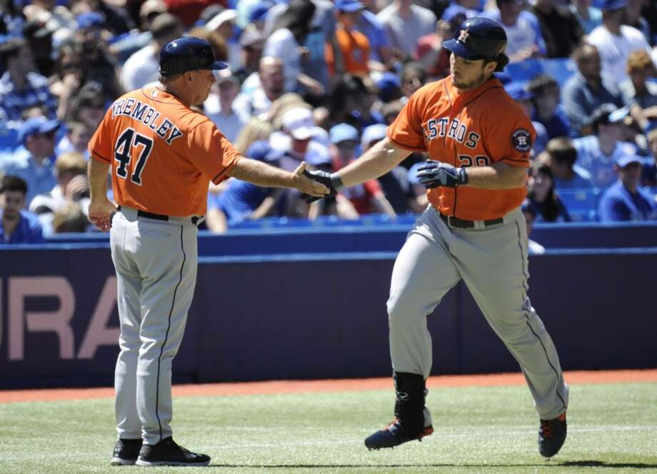 Brett Wallace of the Astros is congratulated by third base coach Dave Trembley after a solo home run in the fourth inning. Photo: Jon Blacker, Associated Press/The Canadian Press