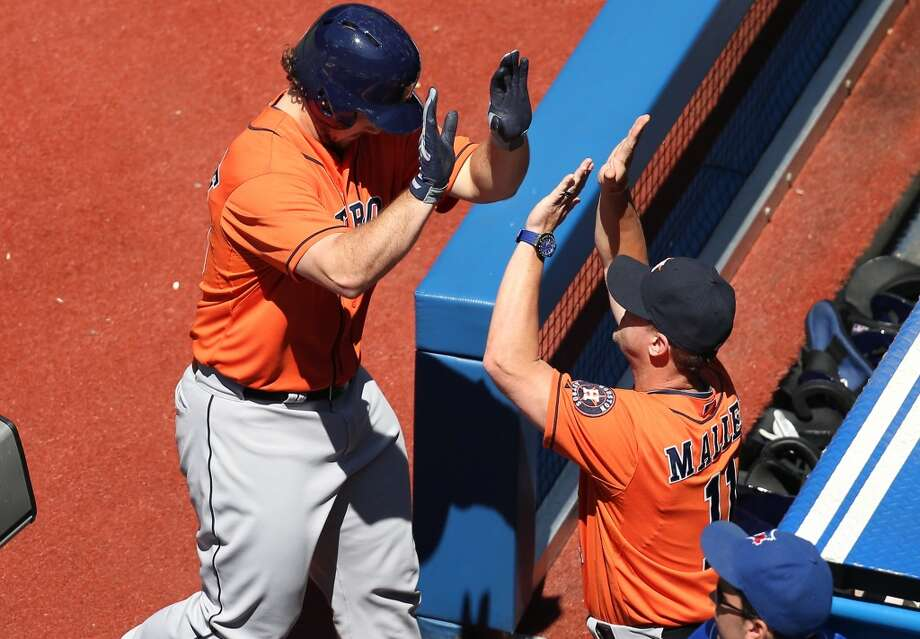 Brett Wallace of the Astros is congratulated in the dugout for his solo shot in the fourth inning. Photo: Tom Szczerbowski, Getty Images