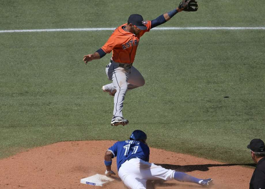 Rajai Davis of the Blue Jays steals second base in the fourth inning during as Jonathan Villar of the Astros jumps for the ball on a throwing error. Photo: Tom Szczerbowski, Getty Images