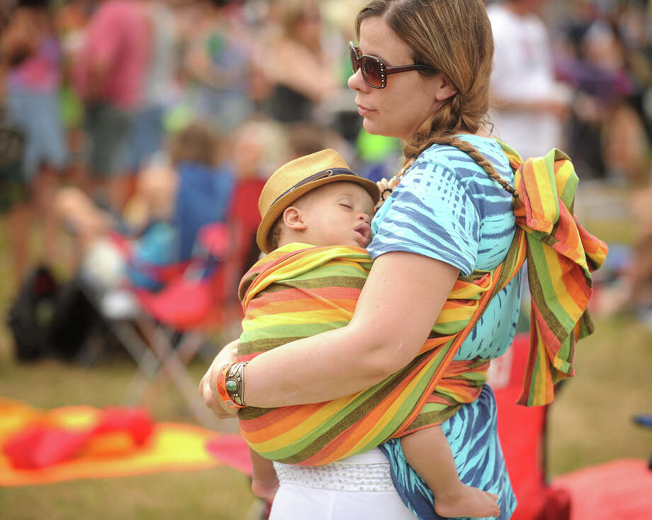 Eva Doll, of Coventry, holds her son Andrew Doll-Wright, 8 months, at the 18th annual Gathering of the Vibes Musical Festival at Seaside Park in Bridgeport, Conn. on Sunday, July 28, 2013. Photo: Brian A. Pounds / Connecticut Post freelance
