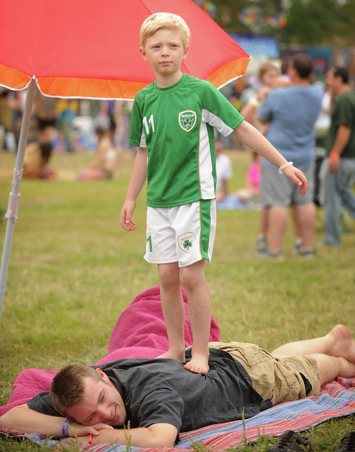 Damien Connolly, of Fairfield, gets walked on by his son Tiernan, 6, at the 18th annual Gathering of the Vibes Musical Festival at Seaside Park in Bridgeport, Conn. on Sunday, July 28, 2013. Photo: Brian A. Pounds / Connecticut Post freelance
