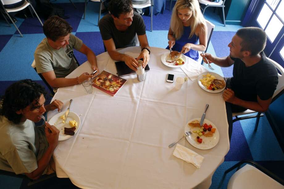 Students at Draper University, a boarding school for wanna-be entrepreneurs, eat breakfast before morning lectures at Draper University in the old Benjamin Franklin hotel in San Mateo, Calif. on July 23, 2013. Photo: Katie Meek, The Chronicle