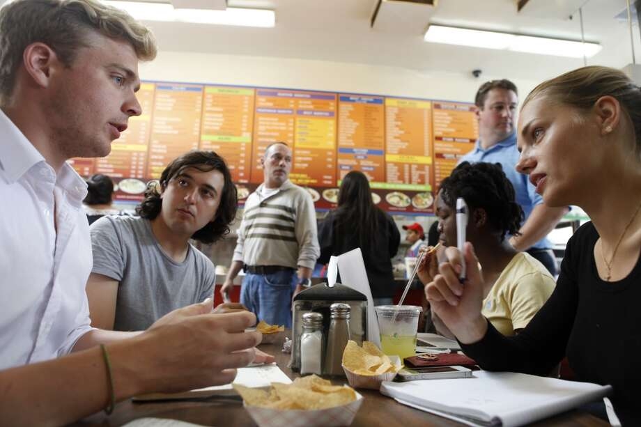 Students at Draper University, a boarding school for wanna-be entrepreneurs, have a business meeting to discuss plans for a start-up over their lunch break in San Mateo, Calif. on July 23, 2013. Photo: Katie Meek, The Chronicle