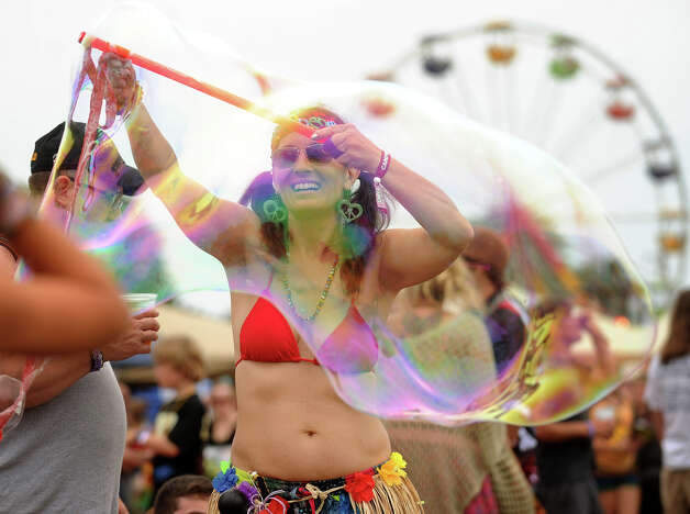 Jade Moon, of Woodstock, NY, creates giant bubbles for the children at the 18th annual Gathering of the Vibes Musical Festival at Seaside Park in Bridgeport, Conn. on Sunday, July 28, 2013. Photo: Brian A. Pounds / Connecticut Post freelance