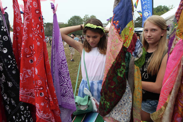 Isabella Kolodziel, 12, and Abigail Cloud, both of Bridgeport, shop at the 18th annual Gathering of the Vibes Musical Festival at Seaside Park in Bridgeport, Conn. on Sunday, July 28, 2013. Photo: BK Angeletti, B.K. Angeletti / Connecticut Post freelance B.K. Angeletti