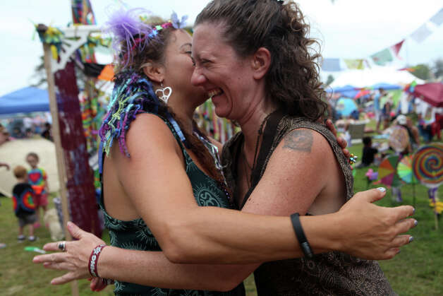 Lauren Ardman, of NY, left, gives Noga Kreiman-Miller, of NY, a hug after join through a Karma Wash at the 18th annual Gathering of the Vibes Musical Festival at Seaside Park in Bridgeport, Conn. on Sunday, July 28, 2013. Photo: BK Angeletti, B.K. Angeletti / Connecticut Post freelance B.K. Angeletti