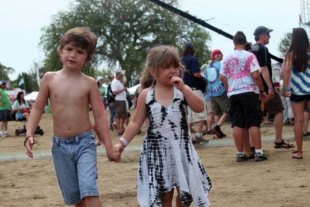 Jeffrey Stanley, 6, of Stratford, and Angela Descheen, 5, of Derby, walk together at the 18th annual Gathering of the Vibes Musical Festival at Seaside Park in Bridgeport, Conn. on Sunday, July 28, 2013. Photo: BK Angeletti, B.K. Angeletti / Connecticut Post freelance B.K. Angeletti
