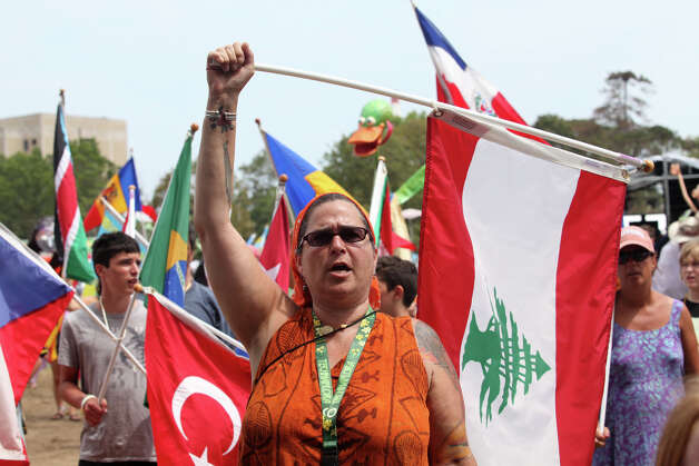 Trouble Mandeson waves a Lebanese flag at the World Peace ceremony at the 18th annual Gathering of the Vibes Musical Festival at Seaside Park in Bridgeport, Conn. on Sunday, July 28, 2013. Photo: BK Angeletti, B.K. Angeletti / Connecticut Post freelance B.K. Angeletti