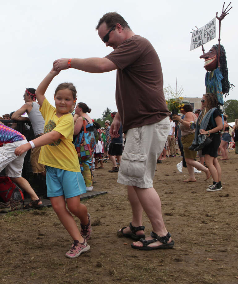 Barrett Lynch, 6, of West Hartford, and her father, Michael, dance at the 18th annual Gathering of the Vibes Musical Festival at Seaside Park in Bridgeport, Conn. on Sunday, July 28, 2013. Photo: BK Angeletti, B.K. Angeletti / Connecticut Post freelance B.K. Angeletti