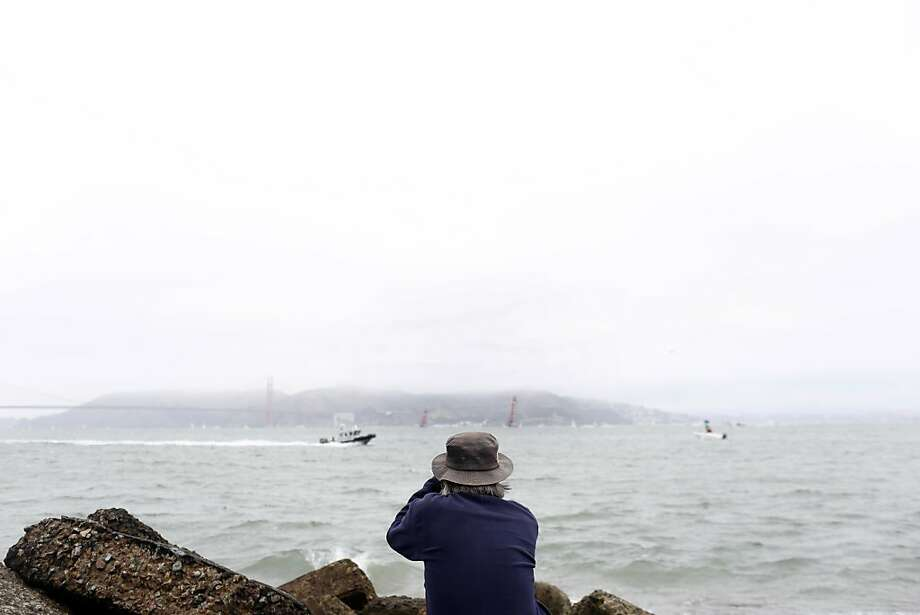 Lyell Warren watches the Emirates Team New Zealand race the Luna Rossa through binoculars during a race for the Louis Vuitton Cup in San Francisco, Calif. on July 28, 2013. Photo: Ian C. Bates, The Chronicle