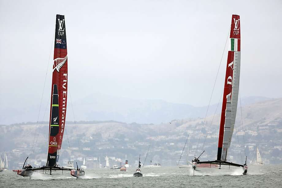 Emirates Team New Zealand, left, and Luna Rossa, right, start the race side by side during a race for the Louis Vuitton Cup in San Francisco, Calif. on July 28, 2013. Photo: Ian C. Bates, The Chronicle