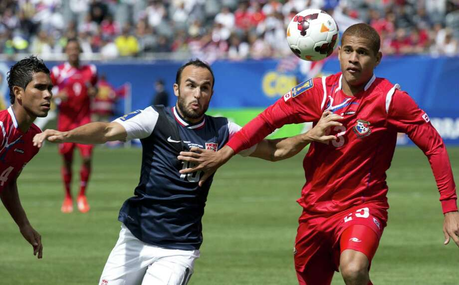 Landon Donovan (L) of the US fights for the ball against Roberto Chen of Panama during the CONCACAF Gold Cup soccer final on July 28, 2013 at Soldier Field in Chicago.   AFP PHOTO/Don EmmertDON EMMERT/AFP/Getty Images Photo: DON EMMERT, AFP/Getty Images / AFP