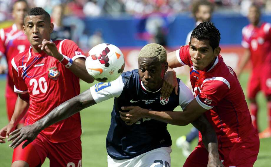 Eddie Johnson (L) of the US fights for the ball against Carlos Rodriguez (R) of Panama during the CONCACAF Gold Cup soccer final on July 28, 2013 at Soldier Field in Chicago.    AFP PHOTO/Don EmmertDON EMMERT/AFP/Getty Images Photo: DON EMMERT, AFP/Getty Images / AFP