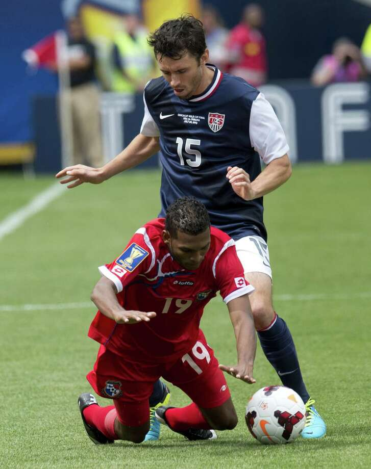 Michael Parkhurst (back) of the US fights for the ball against Alberto Quintero of Panama during the CONCACAF Gold Cup soccer final on July 28, 2013 at Soldier Field in Chicago.   AFP PHOTO/Don EmmertDON EMMERT/AFP/Getty Images Photo: DON EMMERT, AFP/Getty Images / AFP