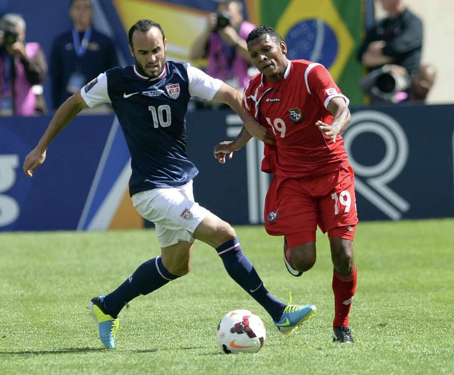 Landon Donovan (L) of the US vies with Panama's Alberto Quintero during the CONCACAF Gold Cup final on July 28, 2013 at Soldier Field in Chicago.     AFP PHOTO / TIMOTHY CLARYTIMOTHY CLARY/AFP/Getty Images Photo: TIMOTHY CLARY, AFP/Getty Images / AFP