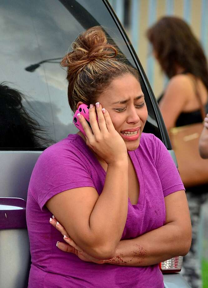 Shamira Pisciotti speaks on the phone Saturday after her parents were slain by the gunman. Photo: Gaston De Cardenas, McClatchy-Tribune News Service