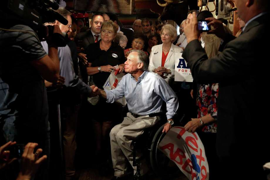 In this July 15, 2013 file photo,Texas Attorney General and Republican gubernatorial candidate Greg Abbott is welcomed by supporters during an appearance in Houston. At 26, Abbott lost the use of both legs when a 75-foot oak tree fell on him. Abbott is the early favorite in next year's race to succeed Gov. Rick Perry, who is not seeking another term. If Abbott wins, he would become the nation's first elected governor in a wheelchair since Franklin D. Roosevelt won New York in 1929. Photo: Pat Sullivan, Associated Press / AP