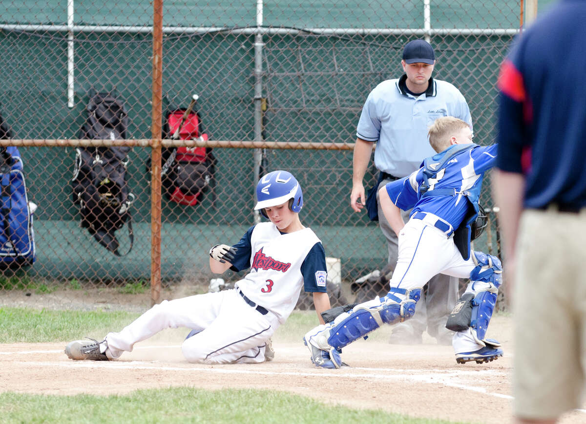 Westport's Max Popken (3) slides into home plate as Coginchaug's catcher Connor Rulnick (8) puts his glove up for the catch during the 12-year-old Little League baseball state finals at Southington South Little League at Recreation Park on Maxwell Noble Drive in Plantsville on Sunday, July 28, 2013.