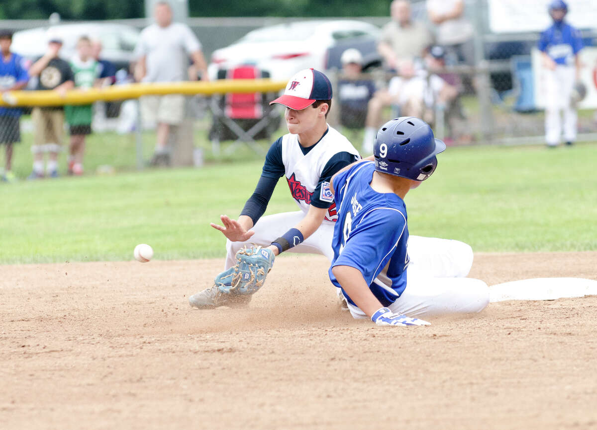 Westport's Ricky Offenberg (15) puts his glove out for the catch as Coginchaug's pitcher John John Jose (9) slides into second base during the 12-year-old Little League baseball state finals at Southington South Little League at Recreation Park on Maxwell Noble Drive in Plantsville on Sunday, July 28, 2013.