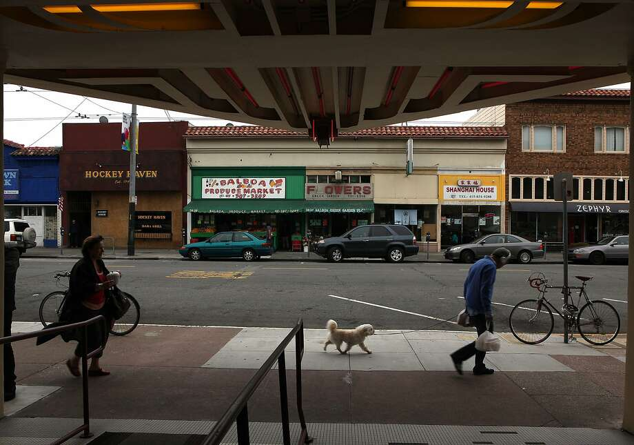 A view of the businesses across the street from under the Balboa theater marquee in San Francisco, Calif., on Friday, July 26, 2013.  The city plans to upgrade Balboa St. from 34th to 39th avenues in the Richmond to attract retail around the Balboa theater. Photo: Liz Hafalia, The Chronicle