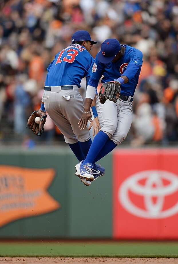 Starlin Castro and Junior Lake leap as the Cubs' sweep left the Giants feeling blue. Photo: Thearon W. Henderson, Getty Images