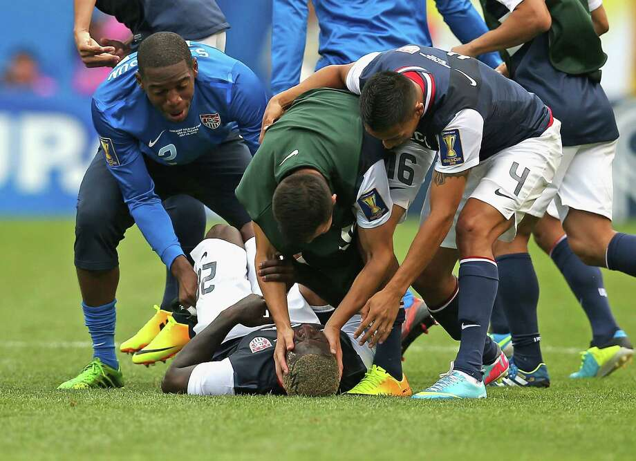 CHICAGO, IL - JULY 28: (L-R) Sean Johnson #12, Jose Torres #16 and Michael Orozco #4 of the United States congratulate Eddie Johnson #26 (on ground) after a win over Panama during the CONCACAF Gold Cup final match at Soldier Field on July 28, 2013 in Chicago, Illinois. The United States defeated Panama 1-0. Photo: Jonathan Daniel, Getty Images / 2013 Getty Images