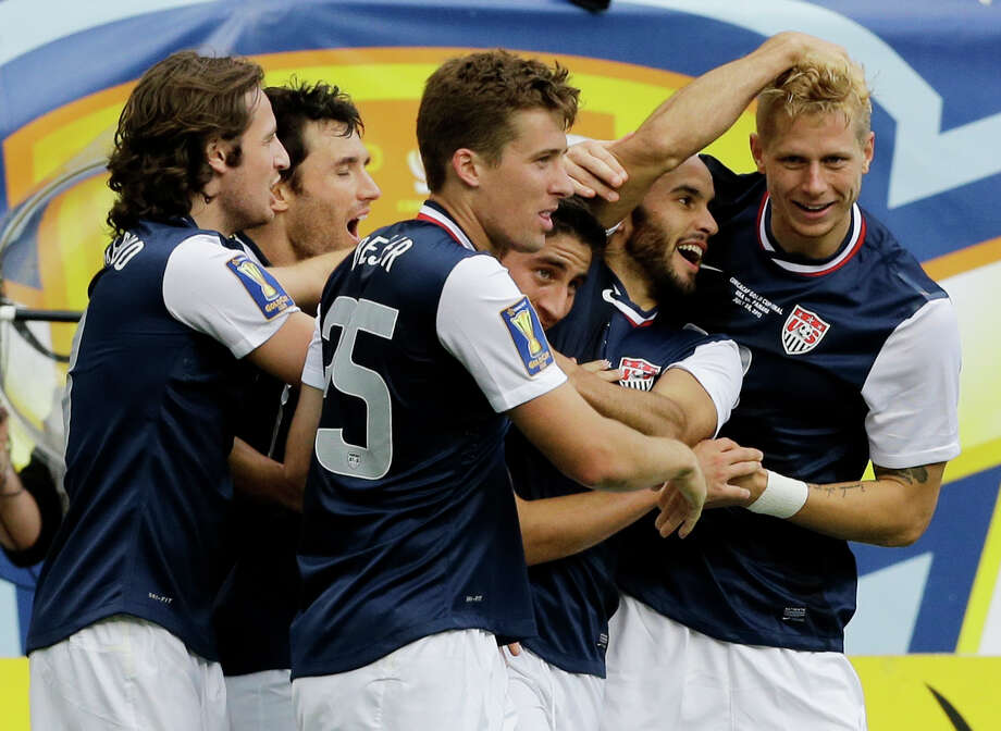 United States' Brek Shea, right, celebrates with teammates after scoring a goal during the second half of the CONCACAF Gold Cup final soccer match against Panama at Soldier Field, Sunday, July 28, 2013, in Chicago. United States won 1-0. (AP Photo/Nam Y. Huh) Photo: Nam Y. Huh, Associated Press / AP