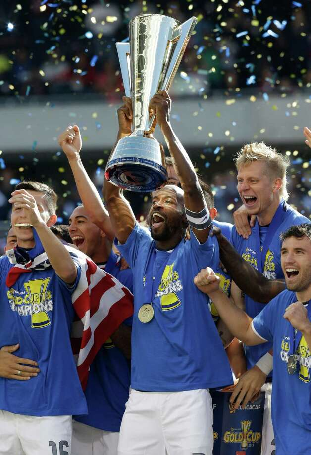 United States DaMarcus Beasley (7), center, holds the trophy as he celebrates with teammates after defeating Panama 1-0 during the CONCACAF Gold Cup final soccer match at Soldier Field on Sunday, July 28, 2013, in Chicago. (AP Photo/Nam Y. Huh) Photo: Nam Y. Huh, Associated Press / AP