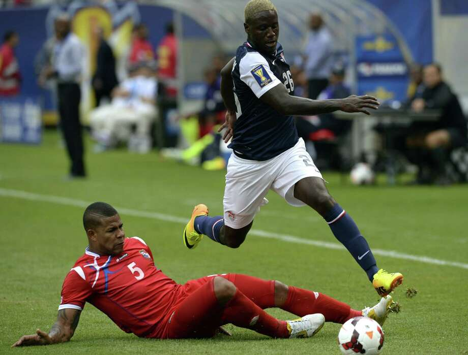 Eddie Johnson (R) of the US and Roman Torres of Panama fight for the ball during the CONCACAF Gold Cup final on July 28, 2013 at Soldier Field in Chicago . The US defeated Panama 1-0.     AFP PHOTO / TIMOTHY CLARYTIMOTHY CLARY/AFP/Getty Images Photo: TIMOTHY CLARY, AFP/Getty Images / AFP