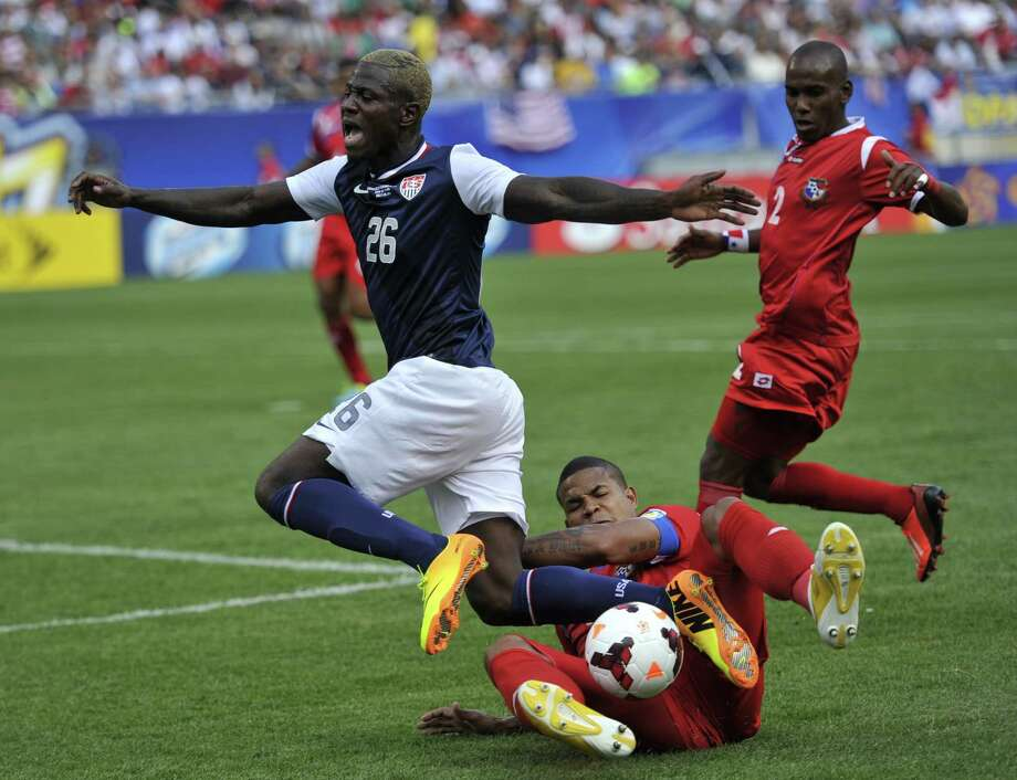 Eddie Johnson (L) of the US and Roman Torres of Panama fight for the ball during the CONCACAF Gold Cup final on July 28, 2013 at Soldier Field in Chicago. The US defeated Panama 1-0.     AFP PHOTO / TIMOTHY CLARYTIMOTHY CLARY/AFP/Getty Images Photo: TIMOTHY CLARY, AFP/Getty Images / AFP