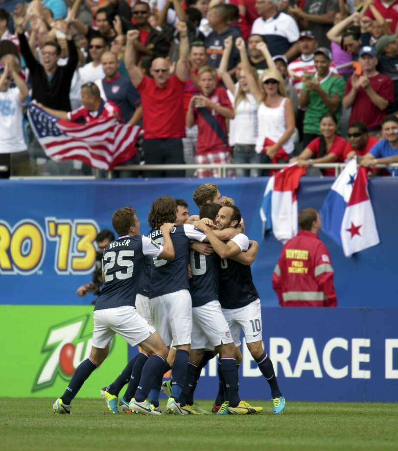 Landon Donovan (R) of the US celebrates with teammates after Brek Shea scored a goal against Panama during the CONCACAF Gold Cup soccer final on July 28, 2013 at Soldier Field in Chicago. The US won 1-0.    AFP PHOTO/Don EmmertDON EMMERT/AFP/Getty Images Photo: DON EMMERT, AFP/Getty Images / AFP