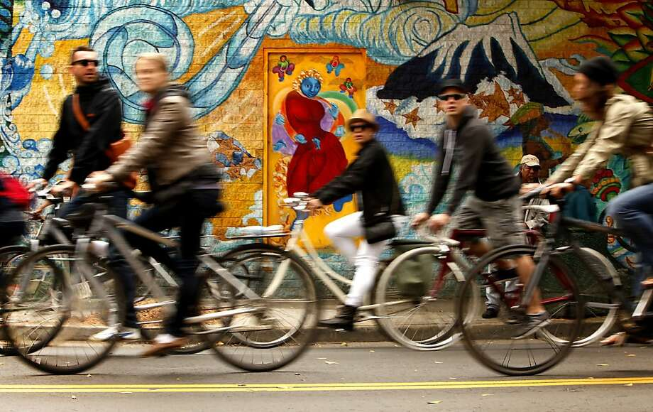 Bicyclists take advantage of a car-free 24th Street during a Sunday Streets event in San Francisco's Mission District. The popular roving street party, started by ex-Mayor Gavin Newsom, is in its sixth year. Photo: Sarah Rice, Special To The Chronicle