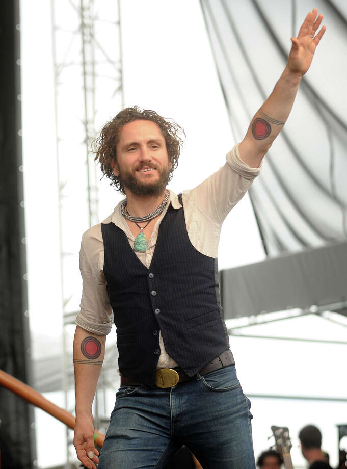 John Butler of the John Butler Trio greets the crowd at the 18th annual Gathering of the Vibes Musical Festival at Seaside Park in Bridgeport, Conn. on Sunday, July 28, 2013. Photo: Brian A. Pounds / Connecticut Post freelance