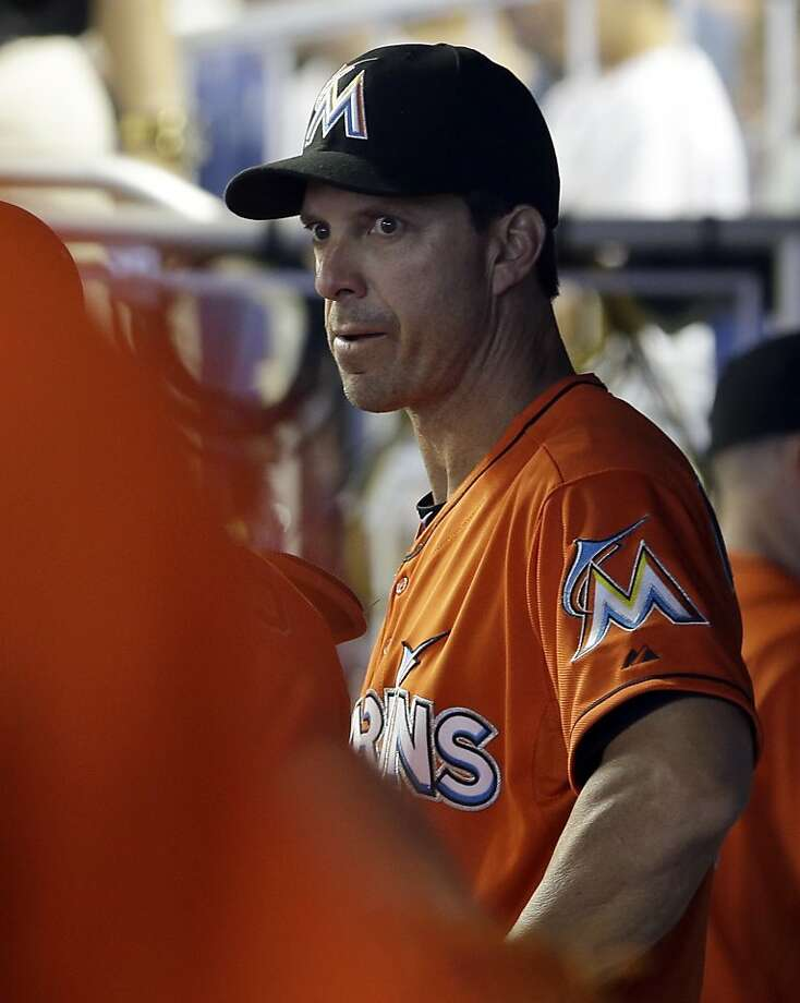 Miami Marlins hitting coach Tino Martinez stands in the dugout during a baseball game against the Pittsburgh Pirates in Miami, Sunday, July 28, 2013. Martinez has resigned after players complained he verbally abused them. (AP Photo/Alan Diaz) Photo: Alan Diaz, Associated Press