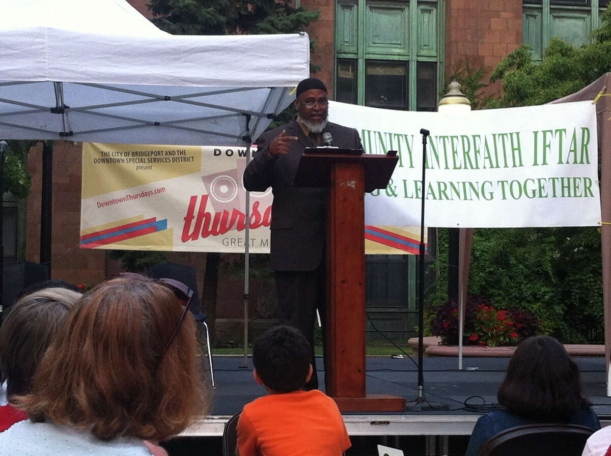 Imam Kashif Abdul-Karim, of the Muhammad Islamic Center of Greater Hartford, explains the significance of the Muslim observance of Ramadan during an interfaith event in downtown Bridgeport on Sunday, July 28, 2013.