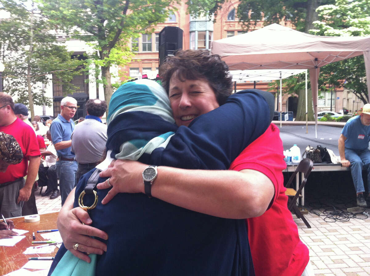 Rev. Sara Smith, of the United Congregational Church, greets Bridgeport resident Rita Hassan with a hug at an interfaith event about the Muslim observance of Ramadan in downtown Bridgeport on Sunday, July 28, 2013.