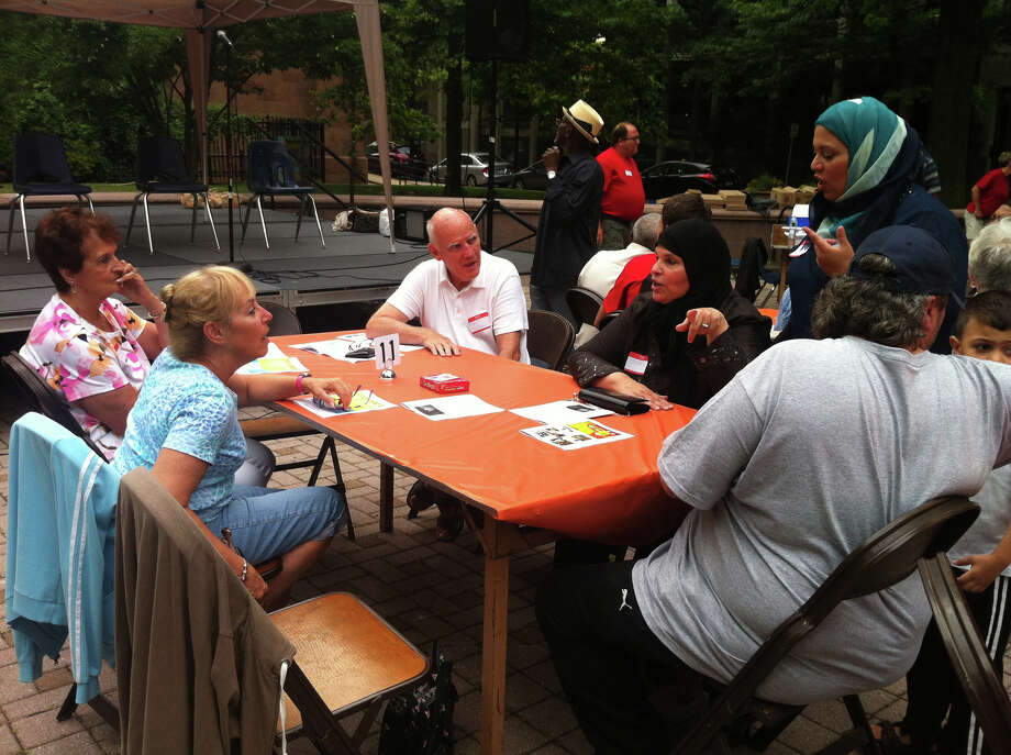 From left: Ellen Bedford, a member of the Congregation Rodeph Sholom, Barbara and Jim Stinson, members of Golden Hill Methodist Church, and Olga and Mohamed Shibtini, of the Bridgeport Islamic Community Center, catch up at an interfaith event in downtown Bridgeport on Sunday, July 28, 2013. Photo: Keila Torres Ocasio / Connecticut Post