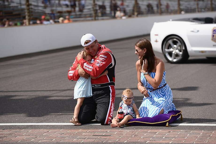 Ryan Newman and his family celebrate among the bricks at the Indianapolis Motor Speedway, where Newman fulfilled his childhood dream with a win. Photo: Michael Loccisano, Getty Images For Crown Royal