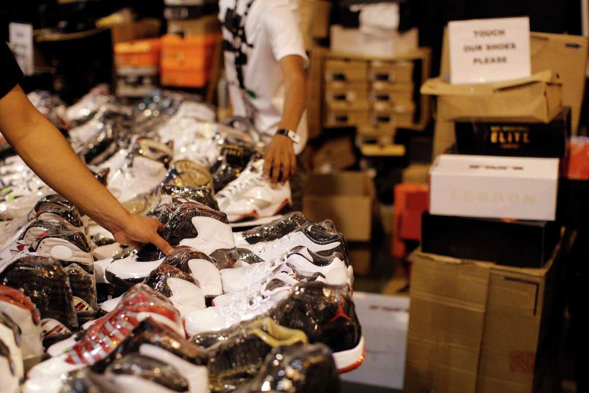 An array of individually shrink wrapped shoes at the 8 One Sneaker House booth is seen during the 2013 H-Town Sneaker Summit at Reliant Center in Houston, Texas.
