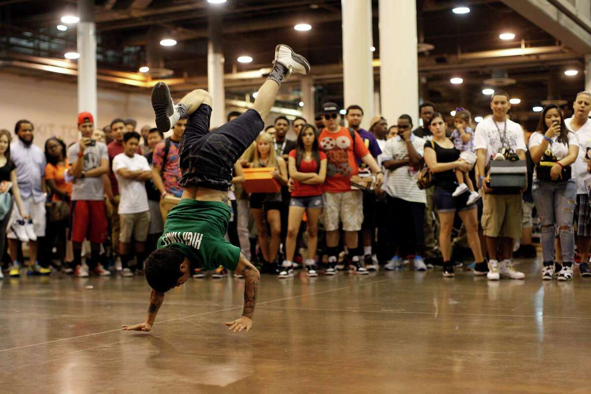 Roy Perez break dances in front of a gathered crowd, during the 2013 H-Town Sneaker Summit.