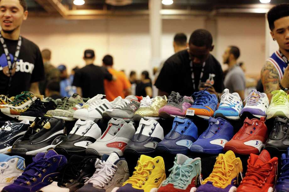 A colorful array of sneakers for sale at the Kick Steady Krew booth is seen during the 2013 H-Town Sneaker Summit. Photo: © TODD SPOTH PHOTOGRAPHY, LLC / © TODD SPOTH PHOTOGRAPHY, LLC