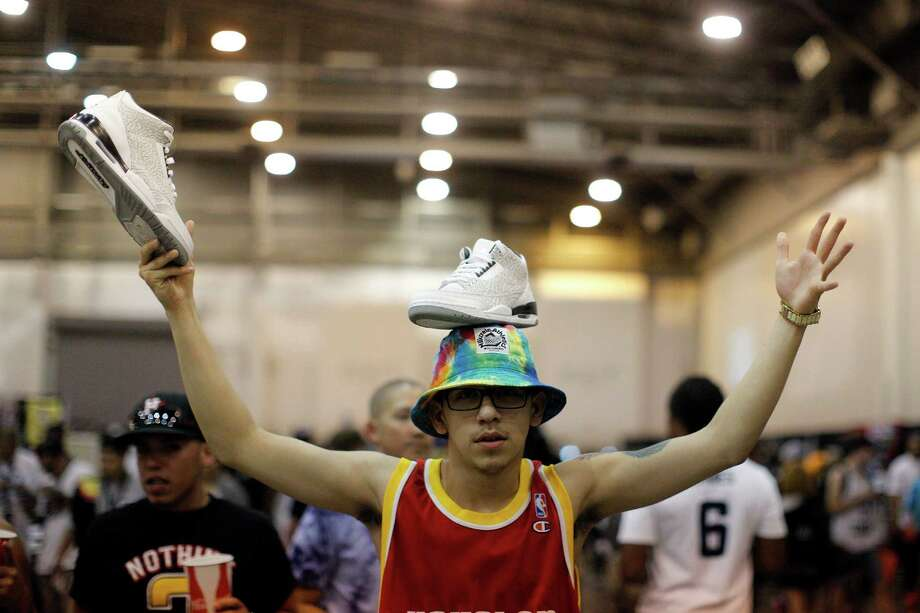 "Matthew ""Flacko"" Capelo finds a creative way to display his shoes for sale during the 2013 H-Town Sneaker Summit at Reliant Center in Houston, Texas.  Photo: © TODD SPOTH PHOTOGRAPHY, LLC / © TODD SPOTH PHOTOGRAPHY, LLC"