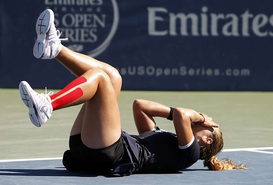 Dominika Cibulkova is floored after she defeated fourth-ranked Agnieszka Radwanska 3-6, 6-4, 6-4 in the final of the Bank of the West Classic at Stanford. Photo: George Nikitin, Associated Press