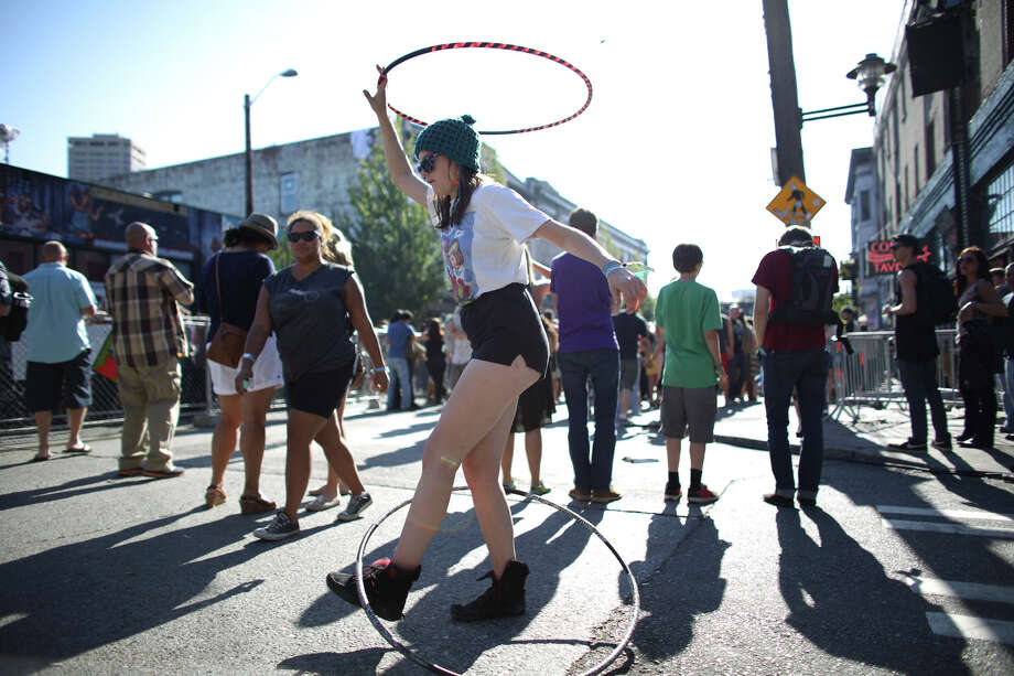 Amelia Akerhielm of Spokane has fun with hula hoops during the annual Capitol Hill Block Party on Sunday, July 28, 2013 in Seattle. The three day music festival wrapped up on Sunday. Photo: JOSHUA TRUJILLO, SEATTLEPI.COM / SEATTLEPI.COM